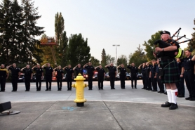 by: Jaime Valdez Beaverton police and TVF&R firefighters  mark the time the Twin Towers fell 10 years ago Sunday, as Tim Birr plays the bagpipes during a private flag ceremony at Station 67.