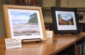 by: KATHLEEN DRAINE The Sandy Public Library is lined with scenes of Oregon, courtesy of Edna Kennel's watercolor display.