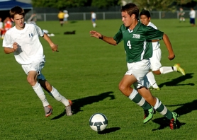 by: DAN BROOD NOT ALONE — Ben White (4) is one of many key returnees for the Tigard boys soccer team this season.