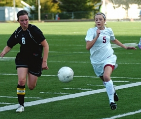by: DAN BROOD BACK FOR THE BOWMEN — Meghan Schoen (right) is one of the key returning players for the Sherwood High School girls soccer team this season.