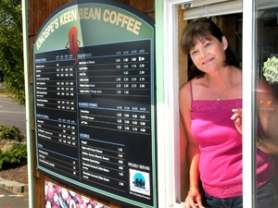 by: Jim Hart Lisa Knospe greets customers through this window at her coffee kiosk, now placed in the parking lot of Geren's Farm Supply near Highway 26 and Kelso Road. The kiosk recently was moved from its previous location on Orient Drive.