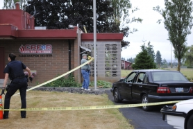 by: Stover E. Harger III Officers place crime scene tape around a black Volvo in front of the Columbia River Fire and Rescue Fairgrounds Station on Saulser Road late Thursday morning. Anthony Connelly of Portland drove this vehicle to the station after reportedly being shot in the head earlier that morning.