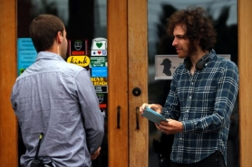 "by: Jaime Valdez ""Portlandia"" Director Jonathan Krisel, right, talks with a crew member Thursday afternoon during filming in front of Good Neighbor Pizzeria on Northeast Dekum Street. The show starring Carrie Brownstein and Fred Armisen wraps up filming its second season this week. A third season is possible, with even more episodes."