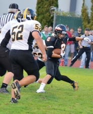 by: John Brewington TOUCHDOWN LEADER-Scappoose's Paul Revis (2) scored three times as the Indians pulled off a 43-25 7-Mile War win over visiting St. Helens.