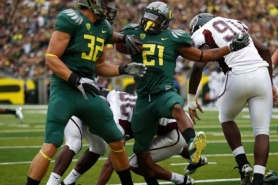 by: JAIME VALDEZ Oregon's LaMichael James (right) celebrates a touchdown with teammate Colt Lyerla in Oregon's victory Saturday over Missouri State.