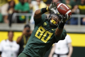 by: JAIME VALDEZ Oregon Ducks receiver Lavasier Tuinei makes a touchdown grab in the 56-7 win Saturday over Missouri State at Autzen Stadium.