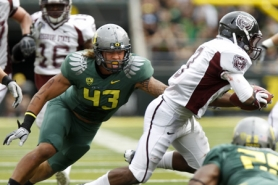by: JAIME VALDEZ Oregon's Keloni Kamalani pursues Missouri State Julian Burton in the first half at Autzen Stadium.