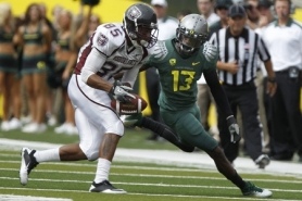 by: JAIME VALDEZ Cliff Harris of Oregon closely defenders Jermaine Saffold of Missouri State during the Ducks' victory Saturday at Autzen Stadium.