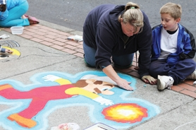 by: John Schrag Sheila Bennett, of Forest Grove, drew Nintendo's heroic plumber with her son, Matthew, during the chalk art festival.