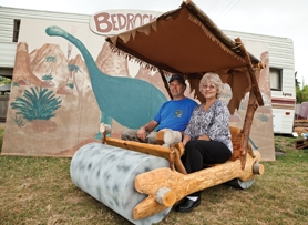 by: Chase Allgood Steve and Marcia Rutledge of Forest Grove will simulate the town of Bedrock when they bring their homemade Flintstone-mobile to the Washington County Fairplex in Hillsboro this weekend as a centerpiece for the Portland Regional Gem and Mineral Show.