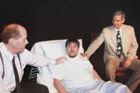 "by: Lisa K. Anderson Bill W. (James Bass) and Dr. Bob (Kevin Fenster) reach out to their first AA member, Billy Dotson (Patrick Roth) in ""Bill W. and Dr. Bob."""