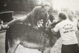 by: ARCHIVE PHOTO Ron Shimma, an employee of Vanport International, hops to first base on his donkey during a 1991 Future Farmers of America donkey baseball game. Local professionals, including the city manager, competed in the game.
