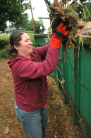 by: VERN UYETAKE Sara Pylate cleans up a home in the Sunset neighborhood of West Linn during the Saturday Neighbors Helping Neighbors events.