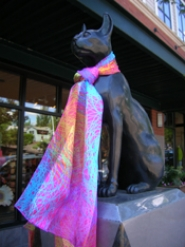 by: STAFF PHOTO  CLIFF NEWELL Bastet, the statue of the Egyptian cat goddess at the intersection of A Avenue and 2nd Street, has been wearing a lovely scarf since its pearl necklace was stolen.