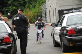 by: Vern Uyetake Ryan Stadnik accelerates on a bike while LOPD Sgt. Tom Hamann clocks his maximum speed.