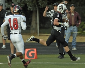 by: DAN BROOD AJ'S TD — Sherwood High School senior A.J. Spencer sprints into the end zone for the Bowmen's first touchdown in Friday's game.