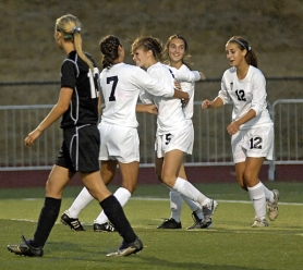 by: DAN BROOD THAT'S A GOOD GOAL — Tualatin sophomore Jill Farley (5) is greeted by teammates (from left) Hana Dempsey, Kelsey Wagner and Cassie Baldwin after she scored the first of her two goals in the win over Tigard.