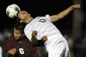 by: JAIME VALDEZ HEAD GAMES — Tigard's Brian Josephson (right) and Tualatin's Javier Miranda battle for the ball in Tuesday's match. The Timberwolves rallied to get a 3-2 win.