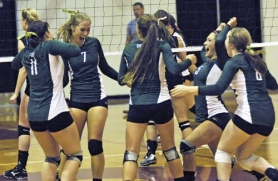 by: DAN BROOD WE DID IT — The Tigard High School volleyball team starts celebrating after scoring the final point in its 19-25, 25-20, 25-13, 25-17 victory over Tualatin in a Pacific Conference match last Thursday.