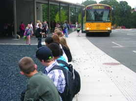 by: Tyler Graf A bus drops off students at Scappoose's Petersen Elementary Sept. 13.