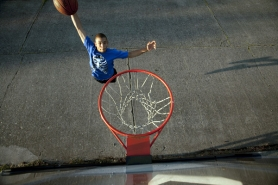 by: CHRISTOPHER ONSTOTT Brandyn Cain plays basketball in the driveway of his family's  