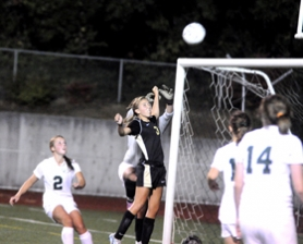 by: MATTHEW SHERMAN  Lakeridge's Erin Elliott wins a ball in the air against West Linn goalie Gabby Estey on a play that led to the Pacers' first goal on Tuesday and one that sparked them to rally from a late 2-0 deficit.