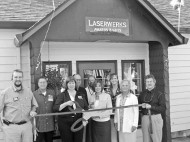 by: SUBMITTED PHOTO At the Sept. 2 ribbon-cutting for Laserwerks' new showroom at 15717 S.E. McLoughlin Boulevard in Milwaukie are, left to right, Sheldon Penner, Doug White, Mary Svela, Bob Svela, Greg Zuffrea, Susan Lehr, Marie Nizich, Deena Jensen and John Wilson. The company does custom laser engraving for employee awards, customers, teams and other groups and can make personalized gifts using photos.