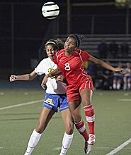by: Miles Vance HEADS UP — Westview senior forward Keirra Butts heads the ball away from Aloha's Dominique Niedziela during the Wildcats' 3-1 win over the Warriors at Aloha High School.