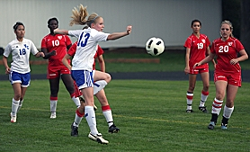 by: Miles Vance IN THE MIDDLE — Valley Catholic junior midfielder Claire McLoughlin and her teammates hope to compete for the District 1 championship in 2011.