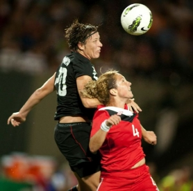 by: chrisTOPHER ONSTOTT U.S. forward Abby Wambach directs a header at the Canadian goal over Carmelina Moscato during the first half of Thursday's 3-0 exhibition victory at Jeld-Wen Field.