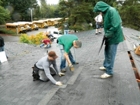 by:  Michael Jeffries Light rain didn't deter Mormon volunteers from replacing the roof of the Head Start building at Mt. Hood Community College on Sept. 17.