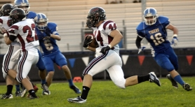 by: DAN BROOD THERE HE GOES — Tualatin senior Alex Fonseca (44) is on his way to a 94-yard kickoff return for a touchdown to kick start the Wolves' 45-0 win at Newberg.