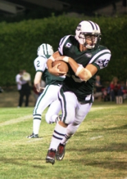 by: Loren Nibbe Ranger running back T. Jay Barber carries most of the load in the run-focused Ranger offense.