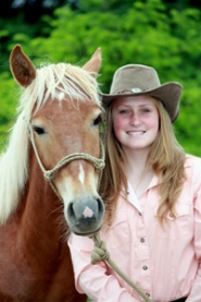 by:  Estacada High School student Sara Ellington adopted her horse Samson once the process was over.