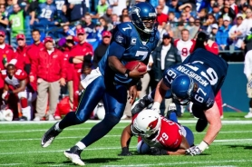by: MICHAEL WORKMAN Tavaris Jackson runs for the decisive touchdown as the Seattle Seahawks defeat the Arizona Cardinals.
