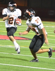 by: John Brewington BIG RETURN—Scappoose's Paul Revis returned this punt 53-yards for a score Friday night and sparked a comeback by the Tribe in the closing minutes of regulation.