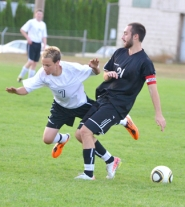 by: John Brewington TRIPPED UP-Scappoose freshman Devin Timmons gets tripped during last week's game with Corbett. He later scored a goal on a penalty kick.