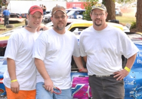 by: John Brewington TRACK CHAMPS-Nusom Racing had two track champions Saturday. Curt Nusom (right) won the Sportsman Division, while brother John (center) won the Street Stock Division. Brad Nusom was also high in points standings and a part of the three-man team.