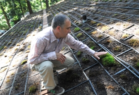 "by: Vern Uyetake Reginald Dechard of Lake Oswego is growing moss on the roof of his home both for aesthetic reasons – because ""everyday will be a new piece of art"" – and for functionality, to keep his home cool in the summer and warm in the winter."