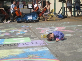 by: Claire Oliver One young festival participant works intently on her artistic creation.