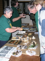 by: photos courtesy of MICHAEL P. JONES/ Cascade Geographic Society The Oregon Mycological Society hosts a table of poisonous and nonpoisonous mushrooms during the two-day festival.