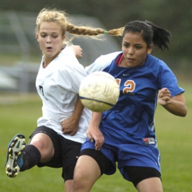 by: David Ball Corbett's Emma Peterson, 7, fights for a loose ball against Umatilla's Selene Tadeo during the Cardinals 3-1 win Tuesday.