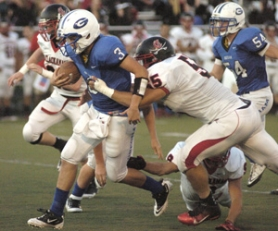 by: David Ball Gresham sophomore QB Devon Shields pulls away from a Clackamas tackler during the Gophers win last week.