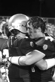 by: MATTHEW SHERMAN Mason Finnerty and Sam Clark celebrate after Friday's emotional win over Canby.