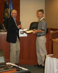 by: LORI HALL West Linn Mayor John Kovash honors Todd Jones with a 2011 Exceptional Service Award.