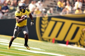 by: CHRISTOPHER ONSTOTT Oregon star LaMichael James takes a punt return to the end zone against Nevada.