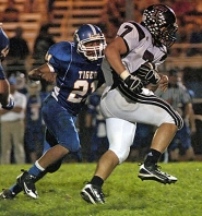 by: DAN BROOD WATTS UP – Tualatin's Brady Watts (right) pulls away from Newberg;s Ruben Pena in Friday's game.