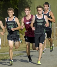by: DAN BROOD IN STRIDE — From left, Tigard's Scott Rice, Tualatin's Scott Allred, Tigard's John Walker and Tigard's Matt Carlson keep up the pace.
