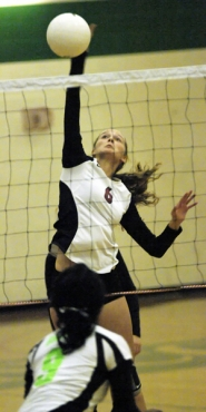 by: DAN BROOD OVER THE NET — Sherwood sophomore Hannah Valesano goes up high to hit a shot in Tuesday's game.