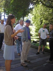 by: ELLEN SPITALERI Tonia Burns, natural resources coordinator for the North Clackamas Parks and Recreation District, left, tells tour participants about the district's local partners in watershed projects.